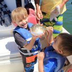 Family fun time on the boat with fishies