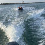 More tubing fun behind the boat