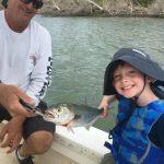 Young boy catching a fish