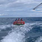 fun times tubing behind the boat