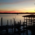 Sunset photo on a dock overlooking the ocean