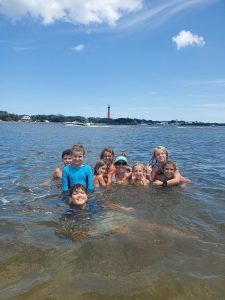 Family having an amazing time in the waters of the Ponce Inlet
